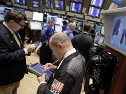 Traders work on the floor of the New York Stock Exchange last week.