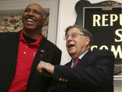 Then-party chairman Michael Steele, left, jokes with John Sununu at a 2010 Republican rally in Concord, N.H.