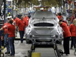 In this March 17, 2011 photo, 2012 Ford Focus vehicles are assembled at the Michigan Assembly Plant in Wayne, Mich.