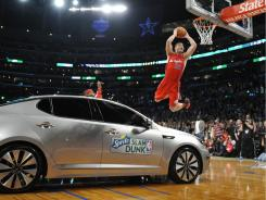 Blake Griffin dunks over a Kia Optima and wins the Sprite Slam Dunk contest, part of February's NBA All Star weekend in Los Angeles.
