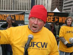 Bill Dudley, an organizing strategist for the United Food and Commercial Workers, speaks at a labor rally in this file photo.