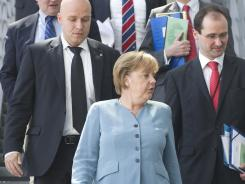 German Chancellor Angela Merkel leaves the parliamentary annex after facing the parliamentary commission charged with EU affairs in Berlin, June 22, 2011.
