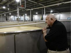 Wild Turkey Master Distiller Jimmy Russell looks over one of the 23 new fermenters the company has installed in an expansion at the plant in Lawrenceburg, Ky., Wednesday, June 15, 2011.