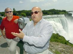 Michael Murphy and his partner, Richard Crogan, speak on June 27, 2011 at the brink of Niagara Falls about the recent passage of the gay marriage bill in New York State and the social and economic effect it will have on the city of Niagara Falls.