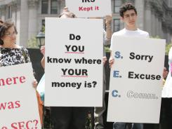 Victims of Bernard Madoff's Ponzi scheme protest outside the federal courthouse in June 2009.