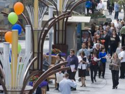 Job seekers stand in line at the Anaheim GardenWalk, waiting to speak with representatives of companies at the third annual Anaheim/Orange County Job Fair, in Anaheim, Calif.,  onJune 15, 2011.