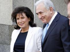 Former IMF chief Dominique Strauss- Kahn leaves New York State Supreme court with his wife Anne Sinclair Friday.
