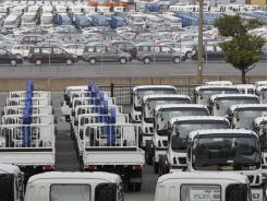 Cars for export are parked at a port in Yokohama, south of Tokyo.