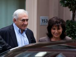 Former International Monetary Fund leader Dominique Strauss-Kahn leaves his temporary residence Saturday in Tribeca.