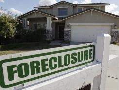 A foreclosure sign outside a home for sale in Phoenix. File photo.