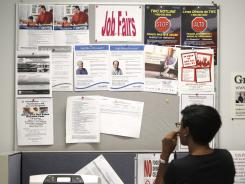 A job seeker looks at a bulletin board at a  job resource center in Richardson, Texas, on July 5, 2011.