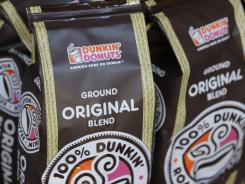 Bags of coffee sit on the shelves at a Dunkin' Donuts store in Indianapolis, Indiana, October 14, 2010.