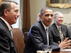 President Barack Obama, flanked by House Speaker John Boehner of Ohio, left, and Senate Minority Leader Mitch McConnell of Ky., meets with Congressional leaders in the Cabinet Room of the White House.