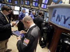 Traders work on the floor of the New York Stock Exchange, June 16, 2011.