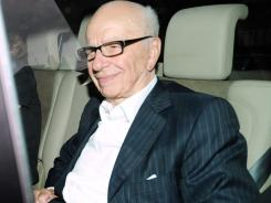 News Corp. chief Rupert Murdoch arrives at his home in Westminster on Monday.