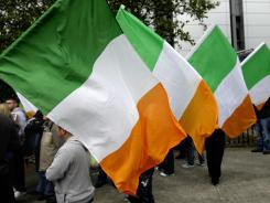 Protesters hold Irish flags during a visit by Britain's Queen Elizabeth to Dublin in May.