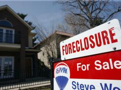 Foreclosure delays might help some financially troubled homeowners, but they also threaten to further postpone the U.S. housing market's recovery, according to a new report.