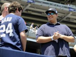 Christian Lopez, right, before a Yankee game Sunday. The day before he caught a home run which also was Derek Jeter's 3,000th career hit.