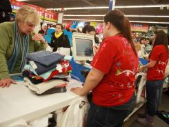 Marsha Barnett-Krause   shops at  Old Navy in Allen Park, Mich., in December 2010. Clothing prices soared 1.4% in June, the most since March 1990.