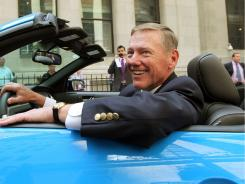 Ford CEO Alan Mulally sits in a Ford Mustang GT outside the New York Stock Exchange after ringing the opening bell on June 7.