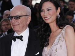 Rupert Murdoch and his wife Wendi Deng arrive for a film screening in Cannes, France, in May.
