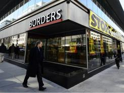 A  Borders bookstore displays banners and placards announcing closing business in Washington, D.C., on March 3, 2011.