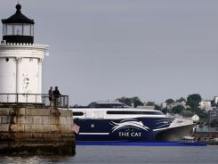 The high-speed Cat ferry leaves Portland Harbor in Portland, Maine, which is rated one of the most affordable places to retire by AARP.