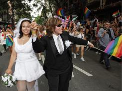 Paola Perez, left, and her partner, Linda Collazo, participate in the annual gay pride parade on June 26 in New York.