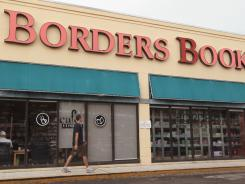 A man walks past a Borders book store on July 1, 2011, in Miami, Florida.