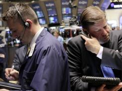 Traders work on the floor at the New York Stock Exchange in New York as government officials continue to argue over the debt ceiling.