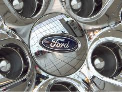 Ford's logo is displayed on a wheel at a car dealership in Omaha.