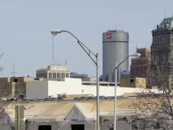 Part of the Detroit skyline is seen behind a housing project under construction in Detroit on April 13, 2011.