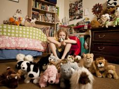 Isabella Sweet, 9, with her Webkinz stuffed animals on the floor in her Davis, Calif., home.