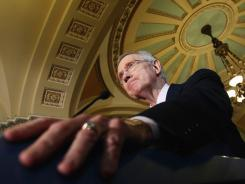 Senate Majority Leader Harry Reid speaks to reporters Tuesday about the debt-limit impasse.