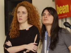 In this 2002  file photo, former News International Chief  Executive Rebekah Brooks, left,  stands next to Sara Payne, mother of murdered girl Sarah, who died at the hands of a pedophile.