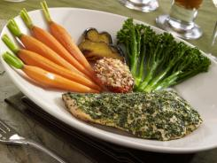 The Cheesecake Factory is launching a new lower-calorie menu which includes an herb-crusted salmon with lemon sauce and assorted fresh vegetables.