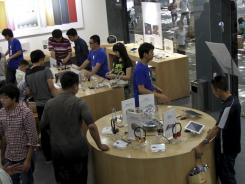 A bite of the Apple:  Customers browse at a fake Apple store in Kunming.