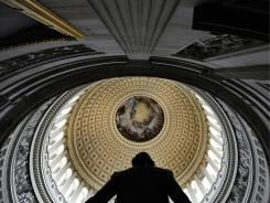 The interior of the Capitol dome, with a statue of George Washington in the foreground.