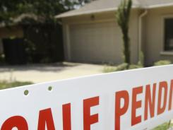 A pending sale sign is displayed in front of a home in Little Rock, Ark. Home buyers are seeing continued low mortgage rates.