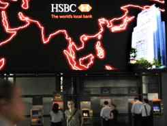 Customers use ATM machines at the HSBC headquarters in Hong Kong on Monday.
