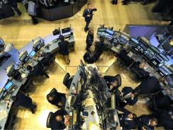 Traders on the floor of the New York Stock Exchange on May 6, 2010 that saw the Dow Jones industrial average dive 700 points within minutes.