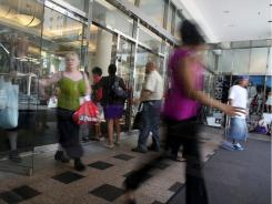 Shoppers leave a department store June 27 in New York City.