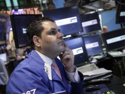 Specialist Samer Farhood at his post Tuesday on the floor of the New York Stock Exchange.