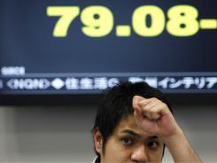 Japan stocks inch higher after move to weaken yen
