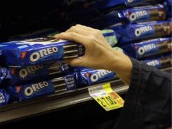A shopper reaches for Oreo cookies by Nabisco - part of the Kraft Foods family of brands.