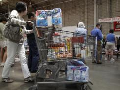 A shopper gets in the check-out line at  Costco in Mountain View, Calif., on June 13, 2011.