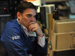 A stock specialist watches prices on the floor of the New York Stock Exchange just before the closing bell last Friday.