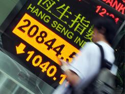A display board shows the Hang Seng Index in Hong Kong on Friday.