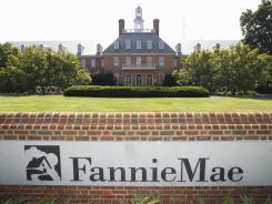 Standard & Poor's downgraded the credit ratings of mortgage lenders Fannie Mae and Freddie Mac and other agencies linked to long-term U.S. debt.