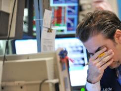 Jason Blatt of Knight Capital Americas reacts to down market on the floor of the New York Stock Exchange Monday.